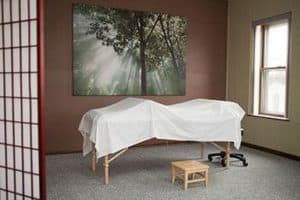 acupuncture relaxing room and bed table